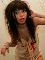 Ihawt043. Petite brunette teen Kaira plays in her elegant skimpy dress.
